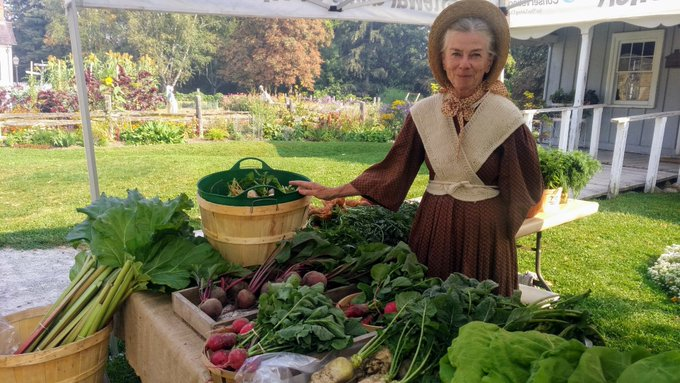 pioneer woman with vegetables for sale